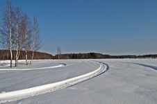 Free Snowmobile Tracks In Winter Field Royalty Free Stock Photo - 29559925