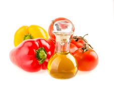 Bottle With Olive Oil ,tomatoes And Peppers Stock Photos