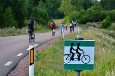 Free Cyclists On The Road And Traffic Sign Stock Photography - 29578102