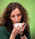 Free Curly Woman With A Cup Of Tea Or Coffee Stock Photography - 29586202
