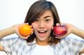 Free Beautiful Asian Teenage Holding Orange And Apple Fruits Near Smi Stock Images - 29594784