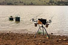 Fishermans Gear At Dam Stock Photo
