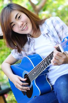 Free Beautiful Asian Woman Holding Guitar Stock Images - 29594934