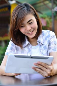 Young Student Have Good News On The Tablet Screen Royalty Free Stock Photos