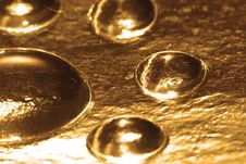 Golden Water Drop Stock Photography