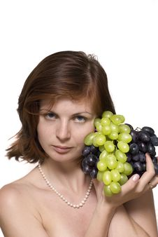 Girl With Grape Royalty Free Stock Images