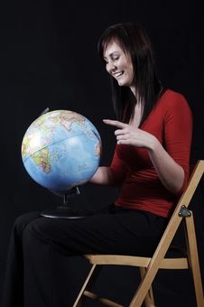 Free Girl Pointing At Globe Royalty Free Stock Photo - 2965485