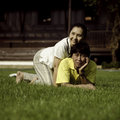 Free Couple Lie On Ground In Park Relaxing Royalty Free Stock Image - 29611416