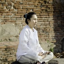 Free Asian Woman Meditating In Ancient Buddhist Temple Stock Photo - 29611380