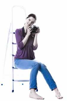 Free Lovely Woman Smiling And Holding A Camera Royalty Free Stock Photo - 29615295