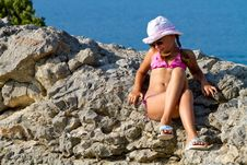 Free Girl Sitting On The Rocks By The Sea Stock Image - 29627511