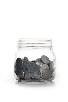 Tin Coins On The Glass Can Stock Photography