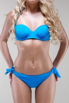 Free Slim Model In Blue Bikini, Studio Shot Stock Image - 29651481