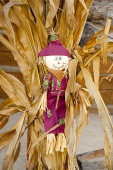 Free Fall Decorations With Scarecrow And Hay Stack. Stock Image - 29652731
