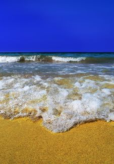 Sea Wave In The Yellow Sand Stock Images