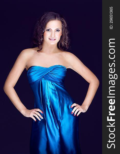 Beautiful brunette in blue dress
