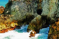 Free Rugged Rocks & Caves Of Tropical Island Cliff Stock Images - 29677514