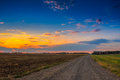 Free Road In Meadows And Beautiful Sunset Royalty Free Stock Photography - 29698877
