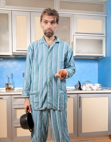 Free Drunk Man Standing In Pajamas With Onion Royalty Free Stock Images - 29696619