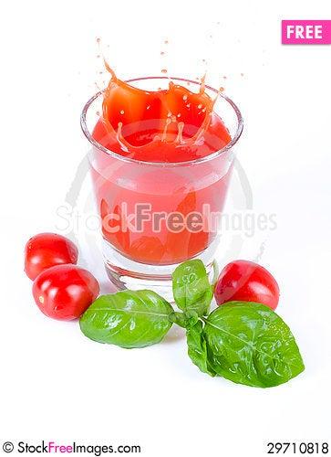 Free Fresh Tomato Juice Splashing With Basil Royalty Free Stock Photos - 29710818