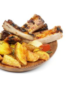 Free Barbecue Pork Ribs And Roasted Potato Stock Images - 29713524