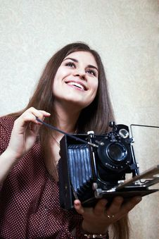 Young Girl And Old Camera Stock Photography