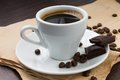 Free Cup Of Coffee And Beans With Chocolate Stock Image - 29738061