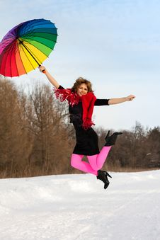 Woman With Color Umbrella In Winter Stock Images