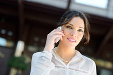 Free Beautiful Smiling Businesswoman On The Phone In A Office Buildin Royalty Free Stock Photography - 29745907