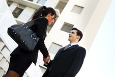 Free Businessman And Businesswoman Shaking Hands Outside Of Office Bu Stock Images - 29745954