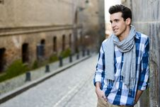 Handsome Man With Modern Hairstyle Smiling In Urban Background Royalty Free Stock Images