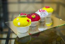 Free Four Delicious Colorful Muffins Stock Photos - 29767263