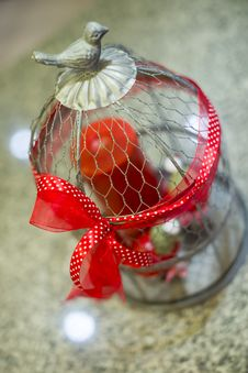 Free Steel Cage Ornament With Red Ribbon Royalty Free Stock Photography - 29767707