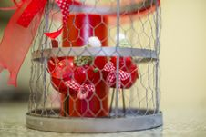 Free Two Small Birds In A Steel Cage Ornament Stock Photography - 29767952
