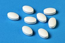 Free Pills On A Blue Background Royalty Free Stock Photo - 29780905