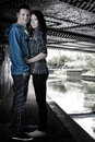 Free Young Cute Couple Hugging Under The Bridge Stock Photos - 29790503