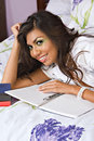Free Hispanic Woman With Notebook Royalty Free Stock Photos - 2981208