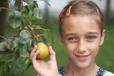 Free Girl Holding A Pear Stock Images - 2987734