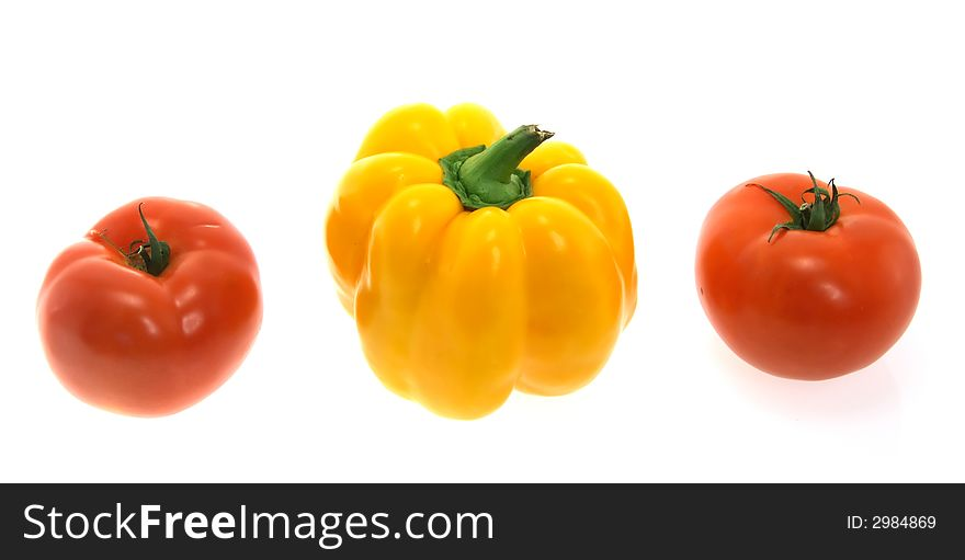 Colorful red tomatos and yellow paprika isolated o