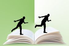 Free Man Running On Book Royalty Free Stock Photo - 29808735