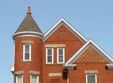Brick House With A Corner Tower Royalty Free Stock Photos