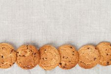 Free Oatmeal Cookies On The Texture Of Flax Stock Photos - 29814213