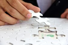 Free Hand Holding A Puzzle Piece, Money Concept Stock Photography - 29822412