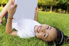 Girl Relax And Reading A Book In The Park Stock Image