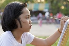 Girl Painting In In The Park Stock Images