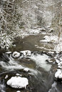 Free Snow Fall On A Narrow Mountain Stream. Stock Images - 29833114