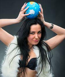 Beautiful Woman Holding A Globe Stock Photo