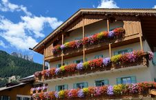 Free Facade Of The Building With Balconies, Decorated With Flowers Royalty Free Stock Images - 29834699