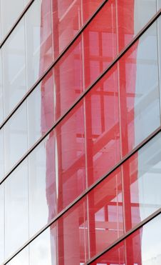 Contemporary Building With Blue Windows And Red Reflection Royalty Free Stock Image