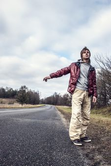 Free Man Hailing On A Roadside Of The Road Royalty Free Stock Photo - 29869205